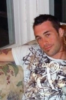 Travis Escanaba